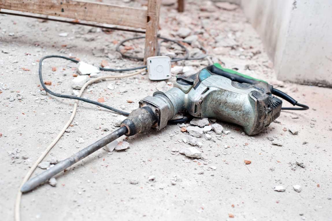 Construction Tool, The Jackhammer With Demolition Debris