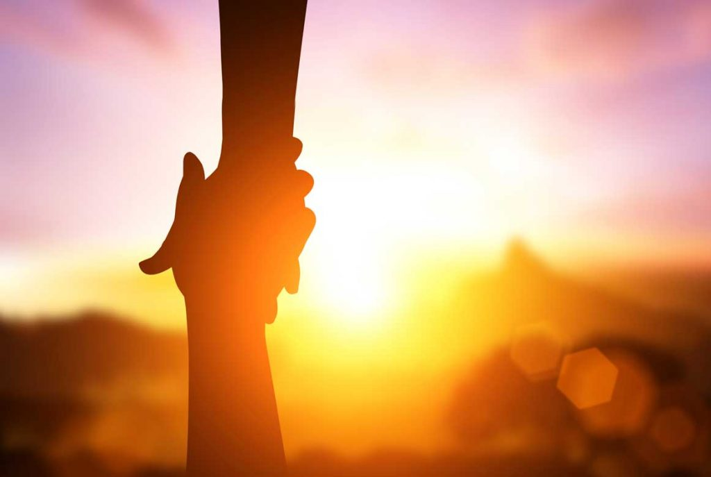 Silhouette Of Helpping Hand And Hope Concept And International Day Of Peace.how Can I Help You